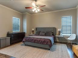 white nightstand under black hanging lamp fresh green thick carpet