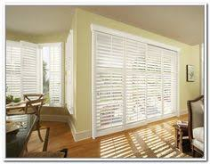 Plantation Shutters On Sliding Patio Doors by Beautiful Three Panel Plantation Bypass Shutter By Budget Blinds