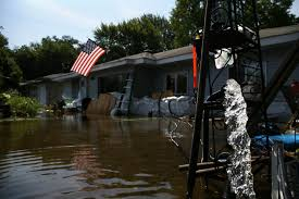 barrington area experiences flooding after heavy rainfall in lake