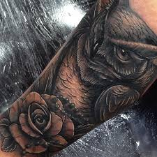 and rose cover up on the leg tattoo by craig holmes iron horse