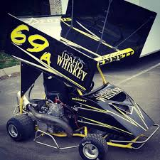 idaho whiskey sponsoring outlaw kart racing action throughout