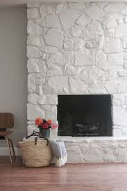 just love this painted rock stacked stone masonry fireplace