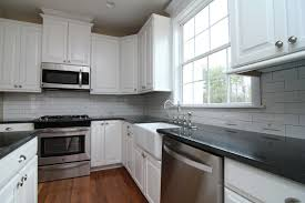 black glass tiles for kitchen backsplashes glass tile backsplash