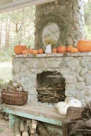 French Country Fireplace - french country cottage outdoor rock fireplace dressed for
