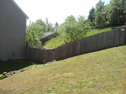 what is the best way to cut gerass on a very steep sloped hill