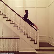 What Does Banister Mean Hilaria Baldwin Perches Her Yoga Toned Figure Atop A Banister In