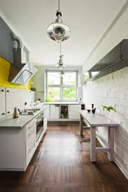 white kitchen cabinets with brick backsplash and white kitchen