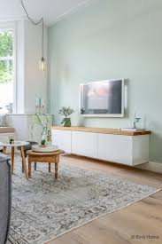 36 ways to decorate your living room like a complete minimalist tv meubel ikea jaren 30 woning woonkamer makeover haarlem bintihome like the wall color