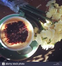 a cup if coffee and some beautiful spring flowers stock photo