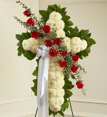 standing cross with a sash of roses funeral flowers