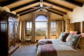 arch window curtains bedroom rustic with beams ceiling fan closet