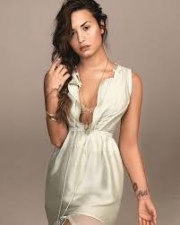 demi lovato tattoos highlighted in recent shoot for glamour