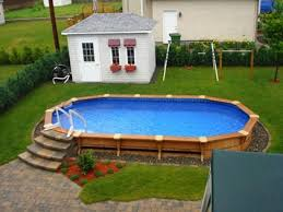 reasonably priced concrete steps wood deck and landscaping around