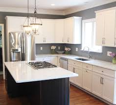 maple cabinets refinished in decorative white tinted lacquer