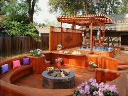 bathroom two level wooden deck with tub using privacy screen