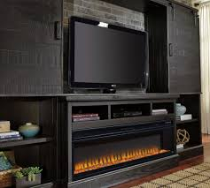 sharlowe entertainment center with wide fireplace insert from