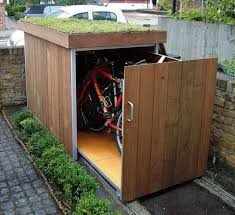 outdoor bike storage ideas with a sliding cabinet to keep safe and