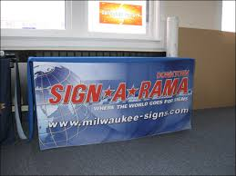 table banners and signs screen printed nylon table cover for a trade show in milwaukee