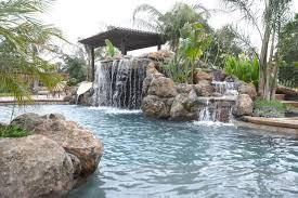 Backyard Pool With Slide 80 Fabulous Swimming Pools With Waterfalls Pictures