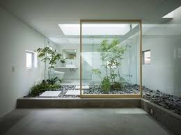 natural japanese style zen bathroom with courtyard and pebbles