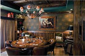 man cave table and chairs 8 man caves meant to inspire your next poker game the brofessional