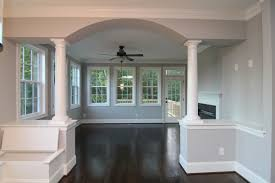 sun room stanton homes beyond this arched entrance with dual white columns is a sun room with two sided fireplace