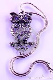 a closeup of a silvery owl ornament with sparkling