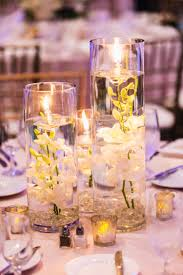 Centerpieces With Candles For Wedding Receptions by Small Candles And Votives For Your Wedding Reception Décor