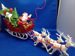 vintage plastic santa claus flocked sleigh reindeer tree