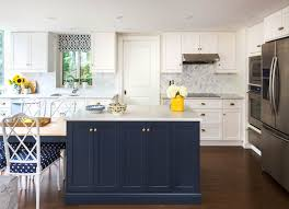 blue kitchen island white and navy kitchen features white shaker cabinets paired with