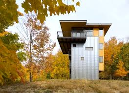 house with tower sustainable metal clad tower house boasts a glass crown overlooking