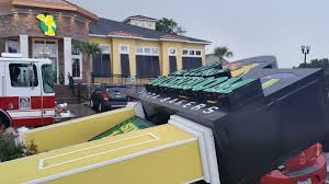 mellow mushroom sign falls on top of parked car in north myrtle