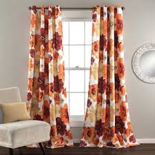 colorful curtains molding with stained baseboard and window trim