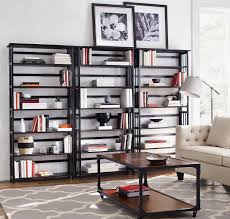 three bookcases of the same height line a wall perfectly keep
