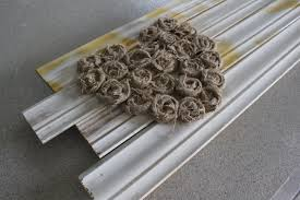recycled baseboard turned wall art simply house to home