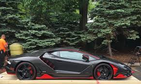 and black lamborghini and black lamborghini centenario delivered in jersey