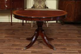 round dining room table with leaf 48 round dining table with leaf round mahogany dining table