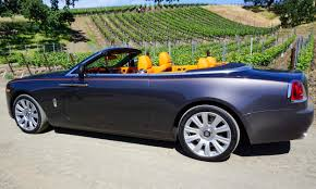 roll royce dawn black the rolls royce dawn drophead coupe mandarin orange brown black