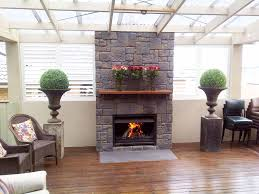 decorating fascinating fireplace mantel kits design for your impressive fireplace surround ideas with marvelous gray stone tile fireplace surround and simple brown wooden fireplace