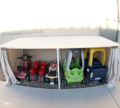Build Wooden Toy Box Plans by Covered Kiddie Car Parking Garage U2013 Outdoor Toy Organization