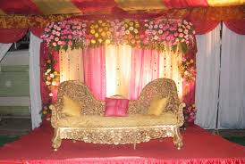 creative wedding stage decoration with flowers and lights