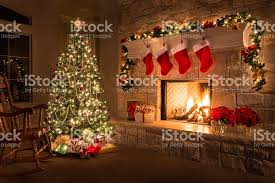 glowing fireplace hearth tree gifts and