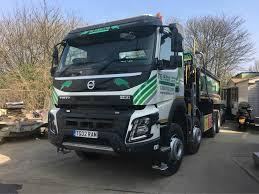 hgv volvo tg ram take delivery of new volvo fmx grab lorry tg ram ltd