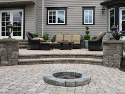Small Patio Pavers Ideas by Grey Stone Patio With White Fountain And Large Green Grass Yard Of