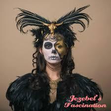golden calf juju voodoo aztec headdress gold gem and black feather