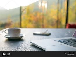 Computer Coffee Table Computer Coffee Mug And Telephone On Black Wood Table Green Flora