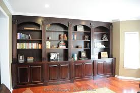 custom made wall unit with bookshelves and storage by oak mountain
