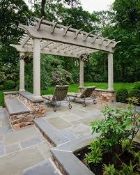 photos hgtv stone patio with lounge chairs under wood pergola