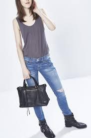 regan satchel black structured tassel satchel bag