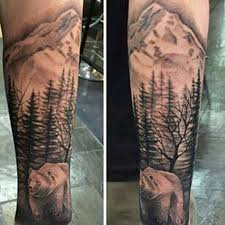 brilliant mountains with and tree on arm sleeve